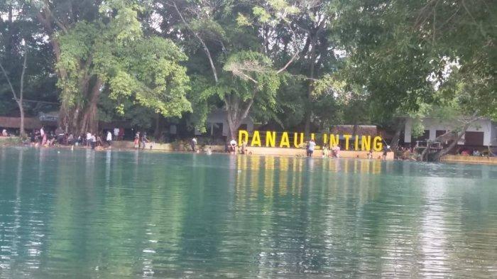 Ket Foto : Suasana Danau Linting pada hari libur tahun baru Rabu, 1/1/2020. (Tribun Medan)
