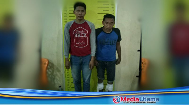 Ket Foto : Febrianto Sinaga penadah (kiri) dan pelaku Syahroni diamankan Polsek Percut Sei Tuan.