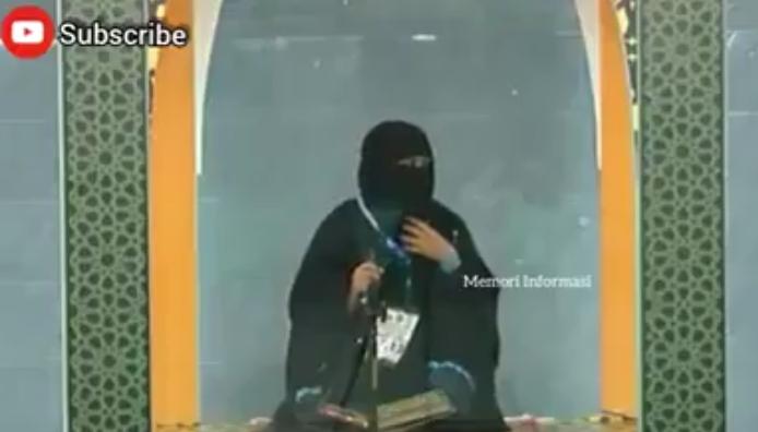 Ket Foto : Ket Foto : Seorang wanita peserta MTQ rela gugur ketimbang membuka cadarnya. [Schrenshoot video akun FB Dakwah Masturah]